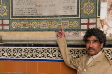 Nutkhut Actor playing Havildar (Sergeant) Umrao Singh by the Victoria Cross mosaic inscription