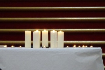The lit memorial candles