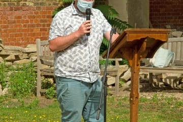 Trinity Vineyard's Paul leads part of the Service
